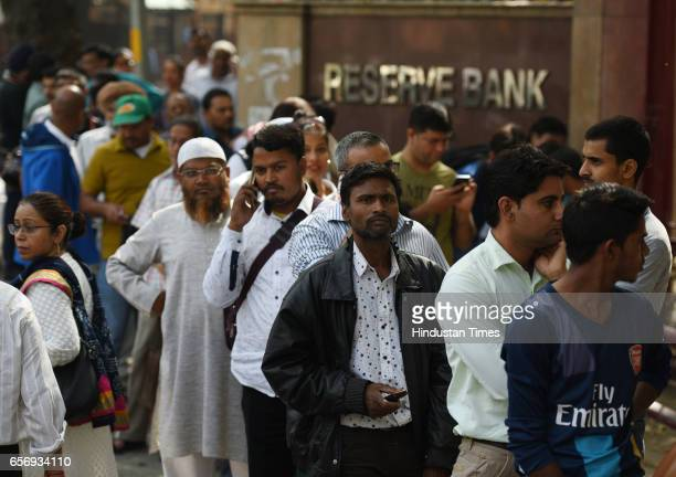 NRIs and PIO wait outside the RBI in New Delhi to get their demonetized currency notes exchanged on March 23 2017 in New Delhi India It's been over...
