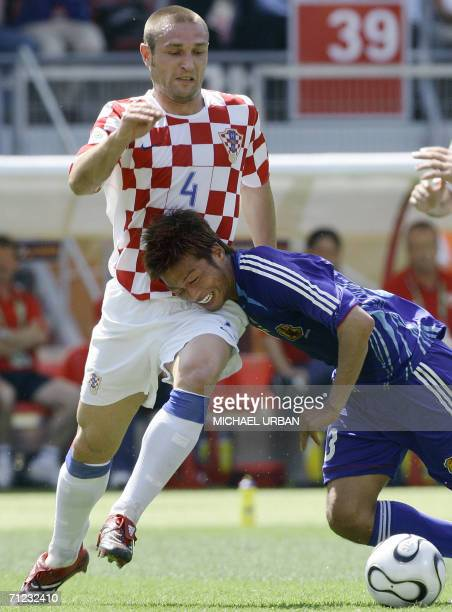 Croatian defender Robert Kovac vies with Japanese forward Atsushi Yanagisawa during the World Cup 2006 group F football match Japan vs Croatia 18...