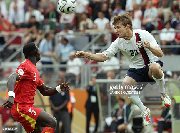 Ghanaian defender John Mensah vies for the ball with US forward Brian McBride during the opening round Group E World Cup football match between Ghana...