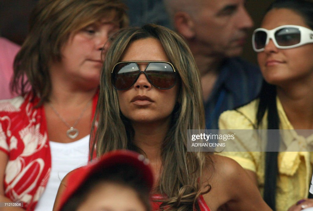 The wife of England's captain David Beckham, <a gi-track='captionPersonalityLinkClicked' href=/galleries/search?phrase=Victoria+Beckham&family=editorial&specificpeople=161100 ng-click='$event.stopPropagation()'>Victoria Beckham</a>, looks on at Nuremberg's Franken Stadium before the start of the opening round Group B World Cup football match between England and Trinidad and Tobago, 15 June 2006. England went on to win 2-0. AFP PHOTO / ADRIAN DENNIS