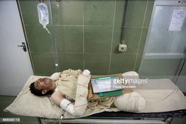 'nSayed Malik waits to go into surgery he lost his legs while demining as a ANA soldier in Sangin 'n As of April 2016 the Emergency hospital stated...