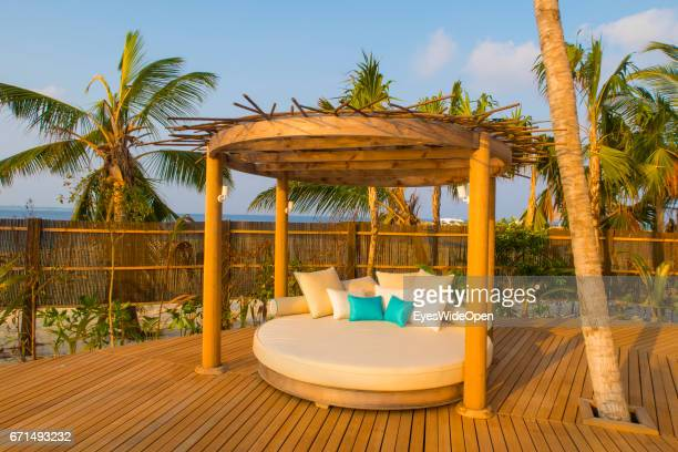 'nSunbed at the Terrace Deck of a BeachVilla and Palm Trees at Lifestyle Resort Milaidhoo Island BaaAtoll on February 23 2017 in Male Maldives