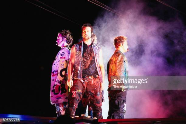'NSync performs at the Network Associates Coliseum in Oakland From left are JC Chasez Joey Fatone and Lance Bass Justin Timberlake is standing behind...