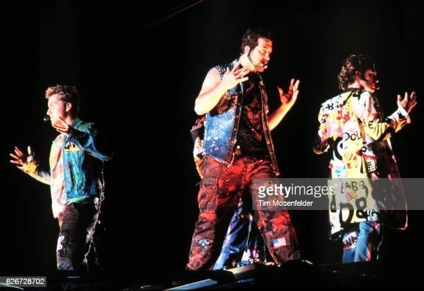 'NSync performs at the Network Associates Coliseum in Oakland From left are Lance Bass Joey Fatone and JC Chasez
