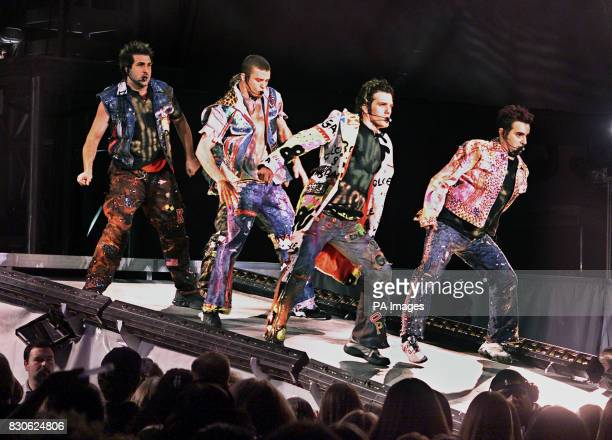 NSync performs their opening number in a concert at Giants Stadium in East Rutherford New Jersey From left Chris Justin Joey and JC Lance is hidden...