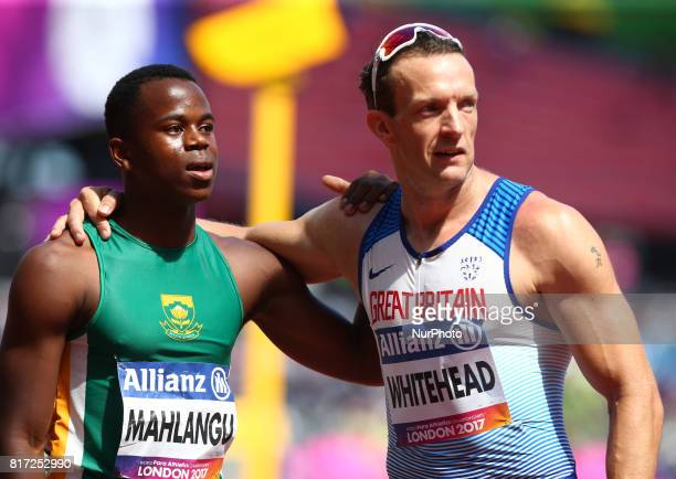 LR Ntando Mahlangu and Richard Whitehead of Great Britain Men's 100m T42 Round 1 Heat 1during IPC World Para Athletics Championships at London...