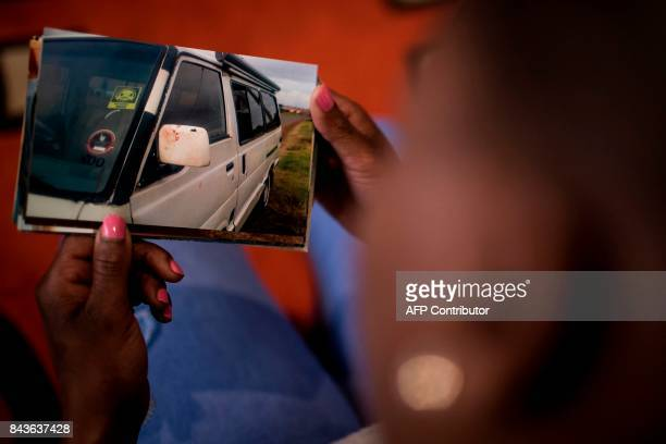 Nthabiseng Mabuza 35 years old holds a photograph showing bloodstain on a minibus taxi where she was raped by the driver on her way to her workplace...