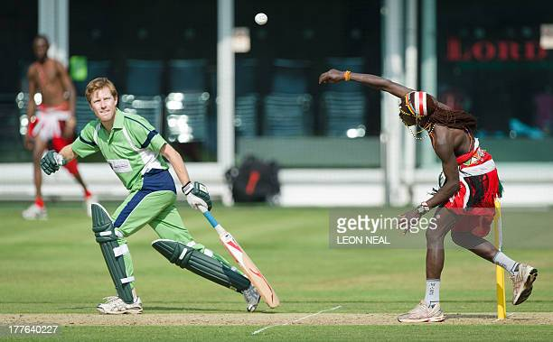 Nturumo Robert Kilesi Pirosis of the Maasai Warrior cricket team from Kenya bowls during a friendly match against the Charity VIII team during...