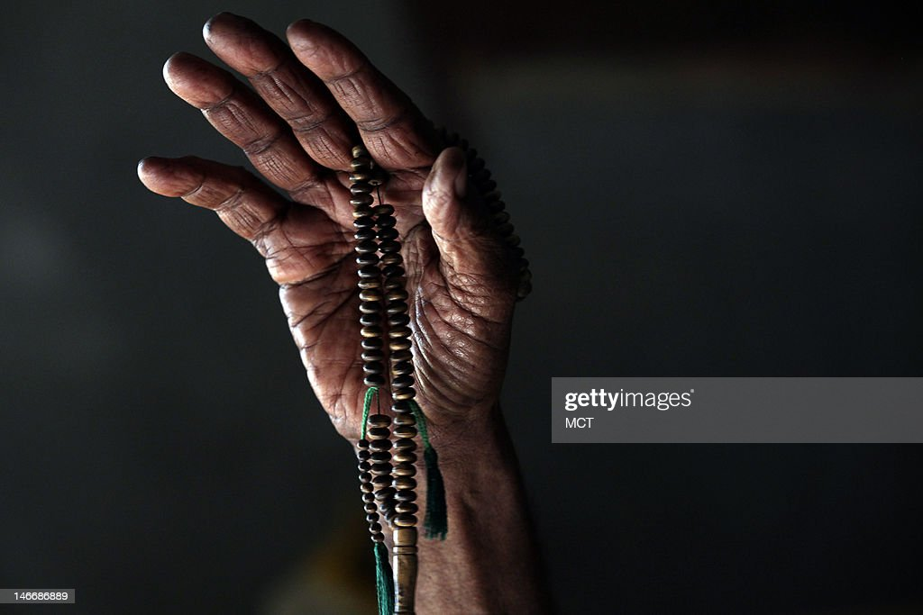 Nubian Bakri Gaffar, 75, a survivor of the displacement from the creation of the Aswan high dam, gestures with his prayer beads as he remembers his village that was submerged in the 1960s, Wednesday, May 16, 2012, in the upper Egypt town of Abu Simbel, where he and his wife now live.