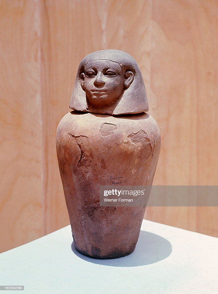 Nubian canopic jar, Under Egyptian influence Nubian rulers adopted their burial customs. Prior to embalming the body the viscera were removed and placed in four protective jars. This one, guarded by Imsety, would have contained the liver of the deceased. Sudan. Nubian. Meroe.