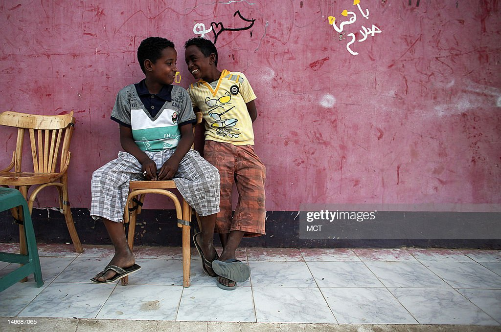 Nubian children play at a coffee shop in a village outside of Aswan, Egypt, Thursday, May 17, 2012.