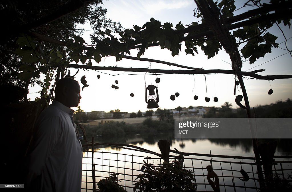 A Nubian man stands near the Nile at sunset in a village outside of Aswan, Egypt, Thursday, May 17, 2012.