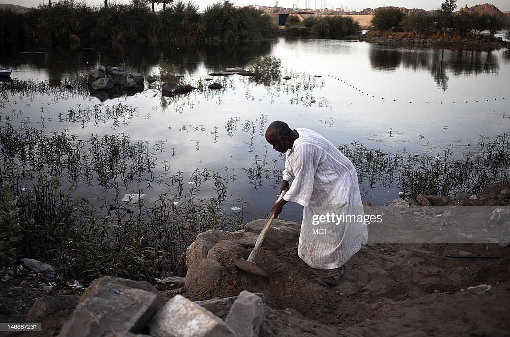 A Nubian man works near the Nile in a village outside of Aswan, Egypt, Thursday, May 17, 2012.