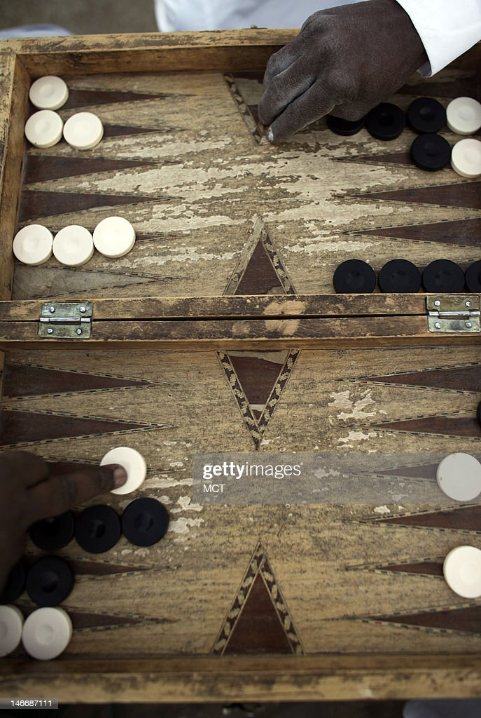Nubian men play backgammon at sunset in a village outside of Aswan, Egypt, Thursday, May 17, 2012.
