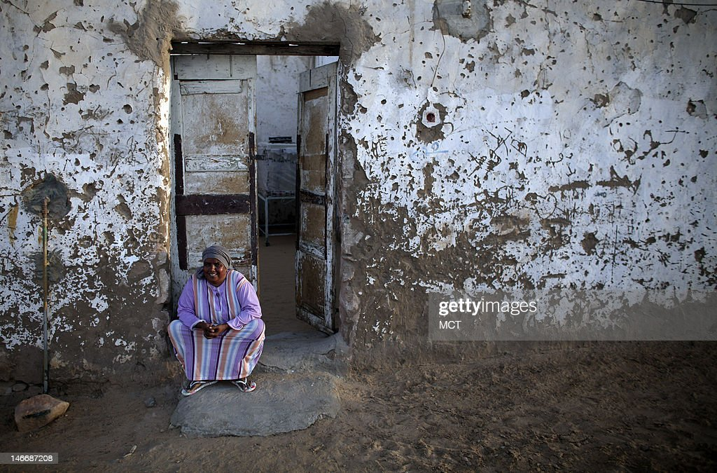A Nubian woman sits outside her house in a village outside of Aswan, Egypt, Thursday, May 17, 2012.