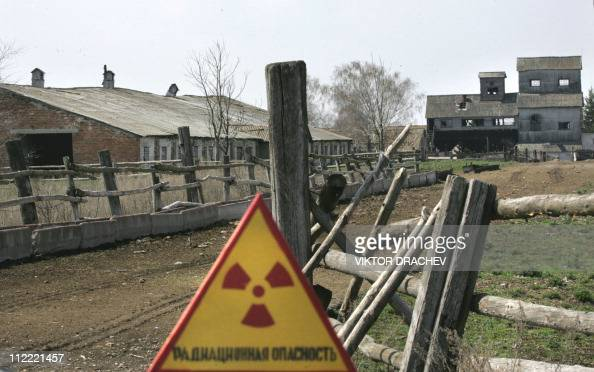 A nuclear danger sign is seen near an abandoned stock buildings inside the 30 km exclusive zone in the village of Dronki some 380 km southeast Minsk...