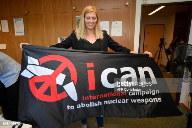 Nuclear disarmament group ICAN executive director Beatrice Fihn holds a banner with their logo after ICAN won the Nobel Peace Prize for its...