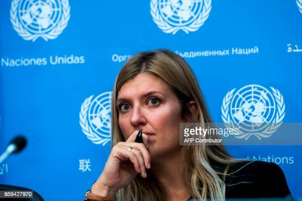 Nuclear disarmament group International Campaign to Abolish Nuclear Weapons executive director Beatrice Fihn listens to a question during a press...