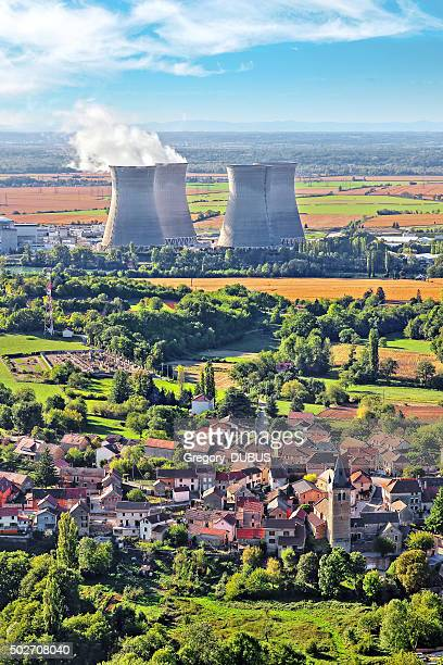Nuclear power station close to countryside village landscape