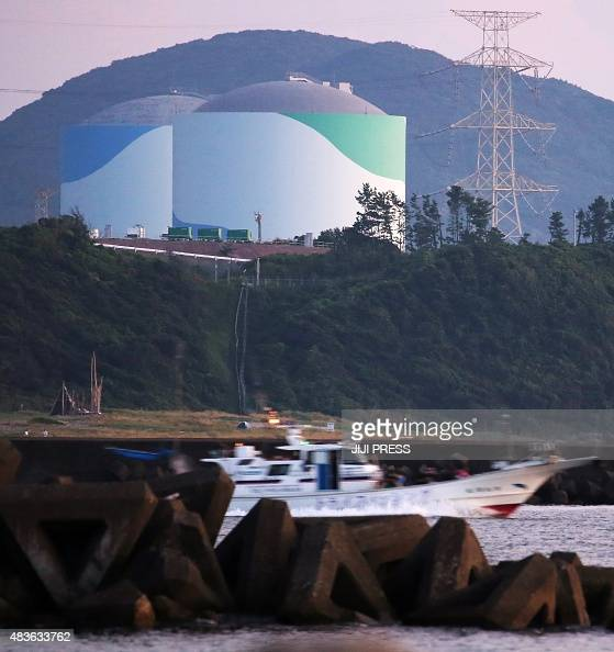 Nuclear reactor buildings of the Kyushu Electric Power Sendai nuclear power plant are seen in the twilight in Satsumasendai in Kagoshima prefecture...