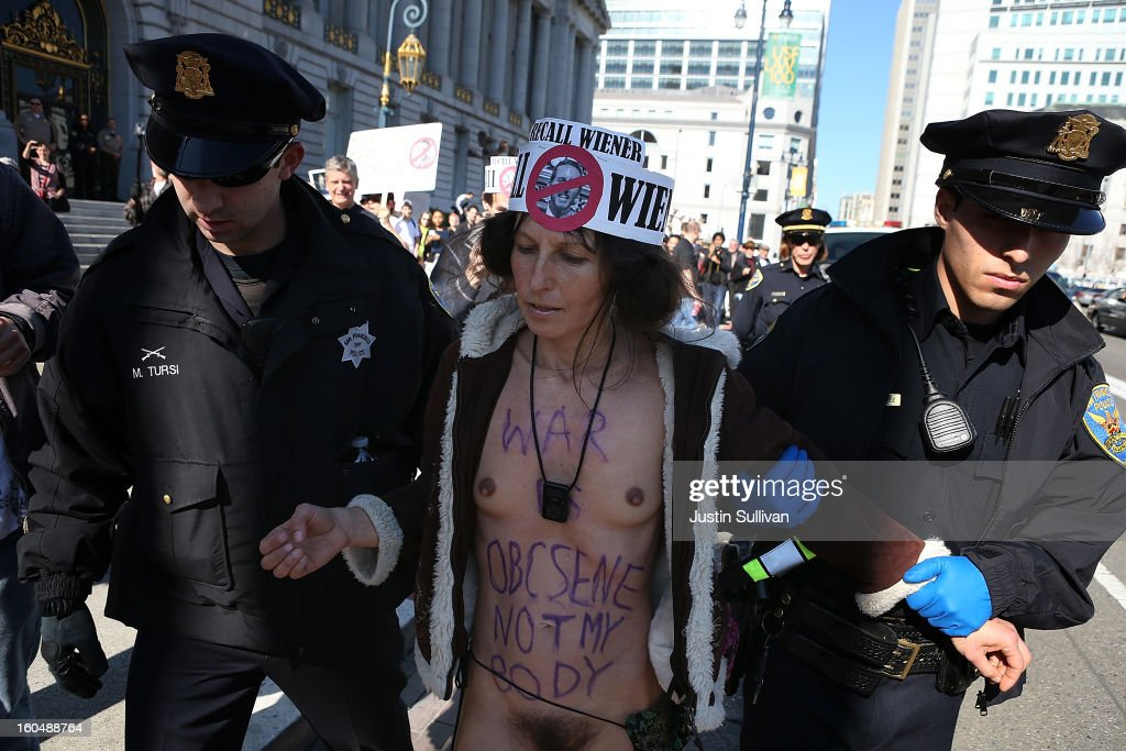 Nude activist Gypsy Taub is arrested by San Francisco police officers as he protests San Francisco's new ban on nudity at San Francisco City Hall on February 1, 2013 in San Francisco, California. At least four nude activists were arrested as they protested San Francisco's new ban on nudity in public places. The measure proposed by Supervisor Scott Wiener is being challenged by activists who call the ordinance unfair because it grants exceptions for nudity at permitted public events.