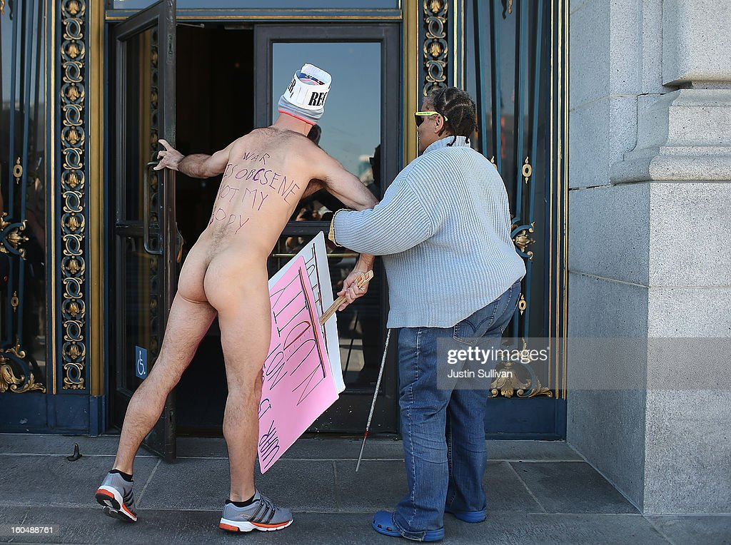 Nude activist Trey Allen helps a blind woman through the front door at San Francisco City Hall as he protests San Francisco's new ban on nudity on February 1, 2013 in San Francisco, California. At least four nude activists were arrested as they protested San Francisco's new ban on nudity in public places. The measure proposed by Supervisor Scott Wiener is being challenged by activists who call the ordinance unfair because it grants exceptions for nudity at permitted public events.