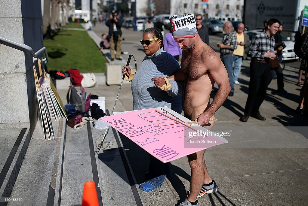 Nude activist Trey Allen helps a blind woman up stairs as he protests San Francisco's new ban on nudity at San Francisco City Hall on February 1, 2013 in San Francisco, California. At least four nude activists were arrested as they protested San Francisco's new ban on nudity in public places. The measure proposed by Supervisor Scott Wiener is being challenged by activists who call the ordinance unfair because it grants exceptions for nudity at permitted public events.