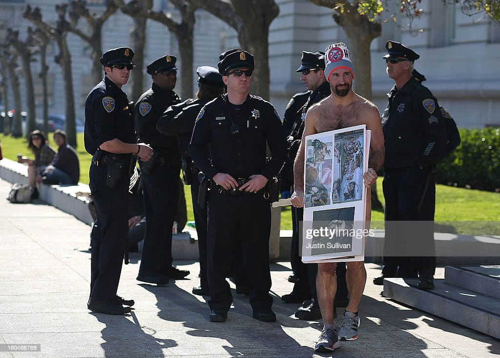 Nude activist Trey Allen stands nude in front of San Francisco police officers as he protests San Francisco's new ban on nudity at San Francisco City Hall on February 1, 2013 in San Francisco, California. At least four nude activists were arrested as they protested San Francisco's new ban on nudity in public places. The measure proposed by Supervisor Scott Wiener is being challenged by activists who call the ordinance unfair because it grants exceptions for nudity at permitted public events.