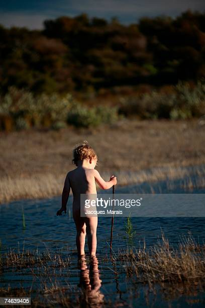 Nude, Baby Boy Playing in Water