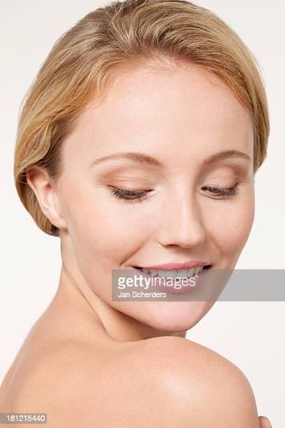Nude Caucasian woman looking over shoulder