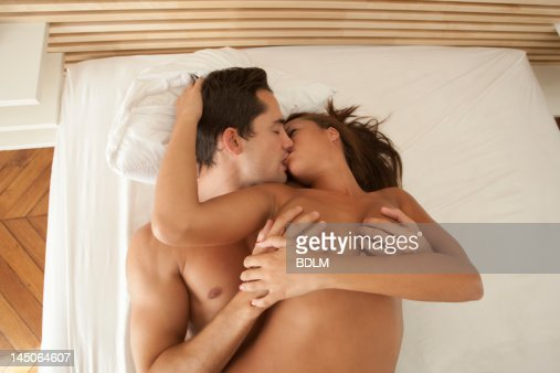 Nude Couple Kissing In Bed Stock Photo | Getty Images