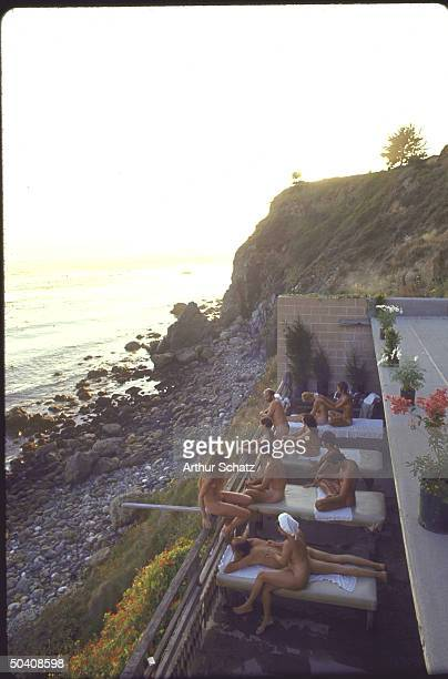 Nude couples on balcony at the Esalen Institute in northern California a place for yoga meditation bongo drums and other staples of the hippie...