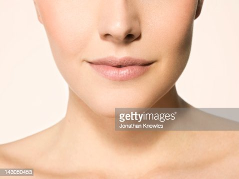 Nude female beauty, close up on lips and shoulders