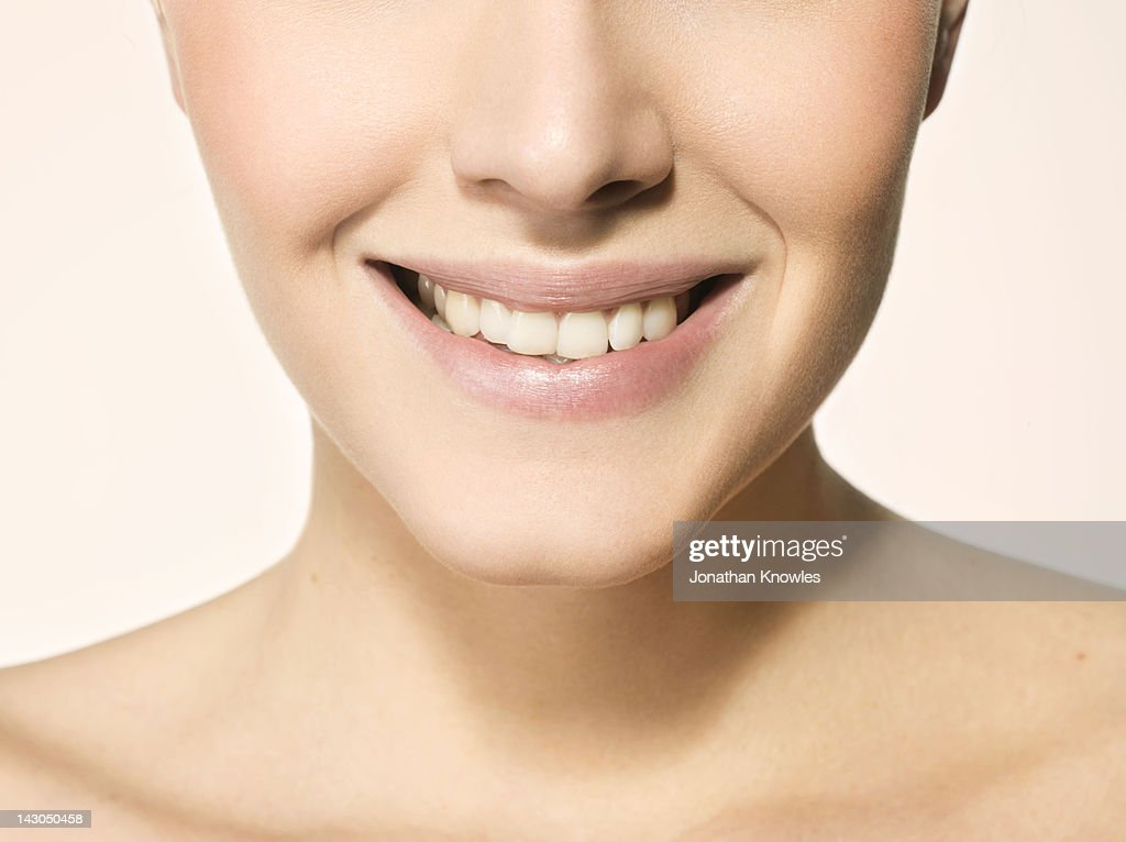 Nude female beauty, close up on lips, smiling : Stock Photo