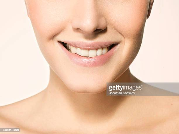 Nude female beauty, close up on lips, smiling