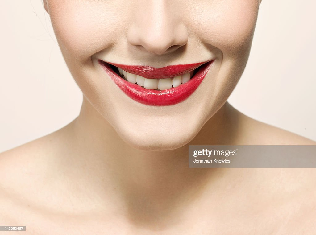 Nude female beauty, close up on lips smiling : Stock Photo