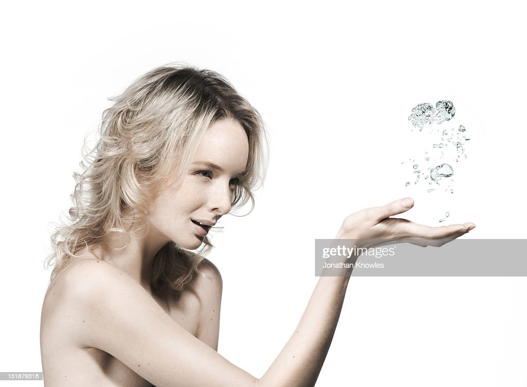 Nude female catching water bubbles fl : Stock Photo