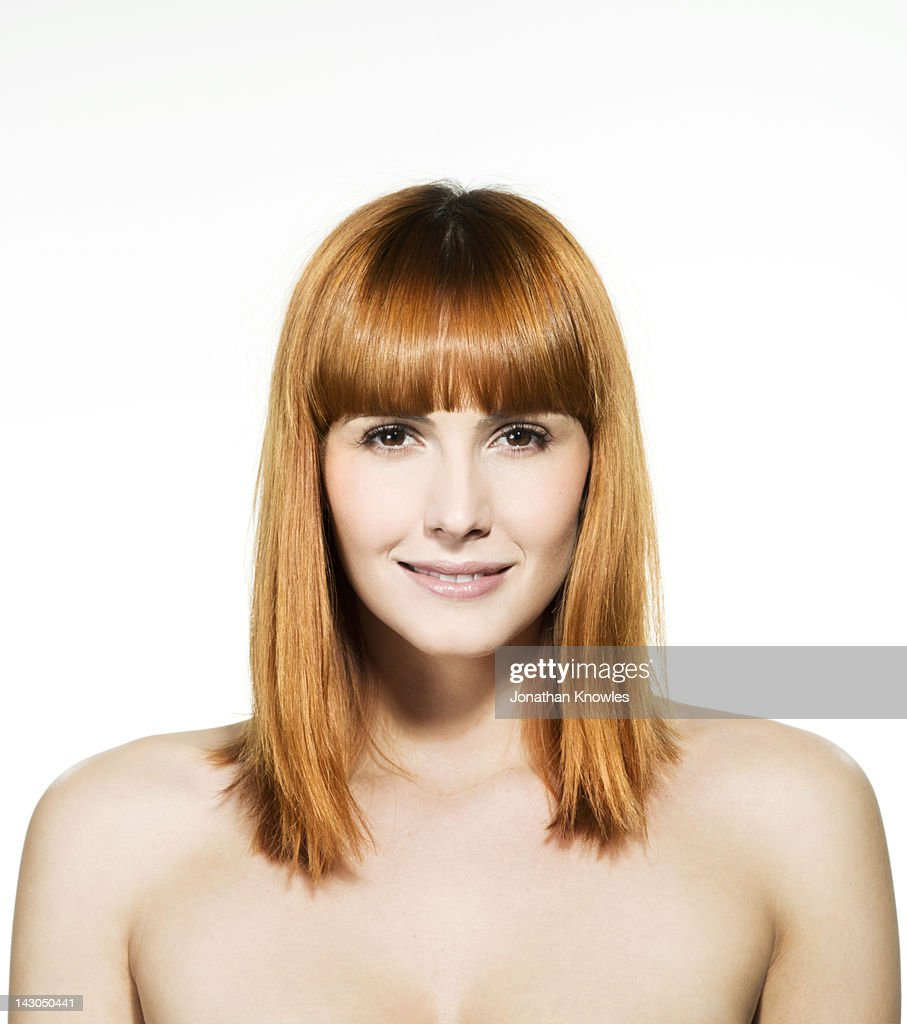 Nude female red hair beauty looking into camera : Stock Photo