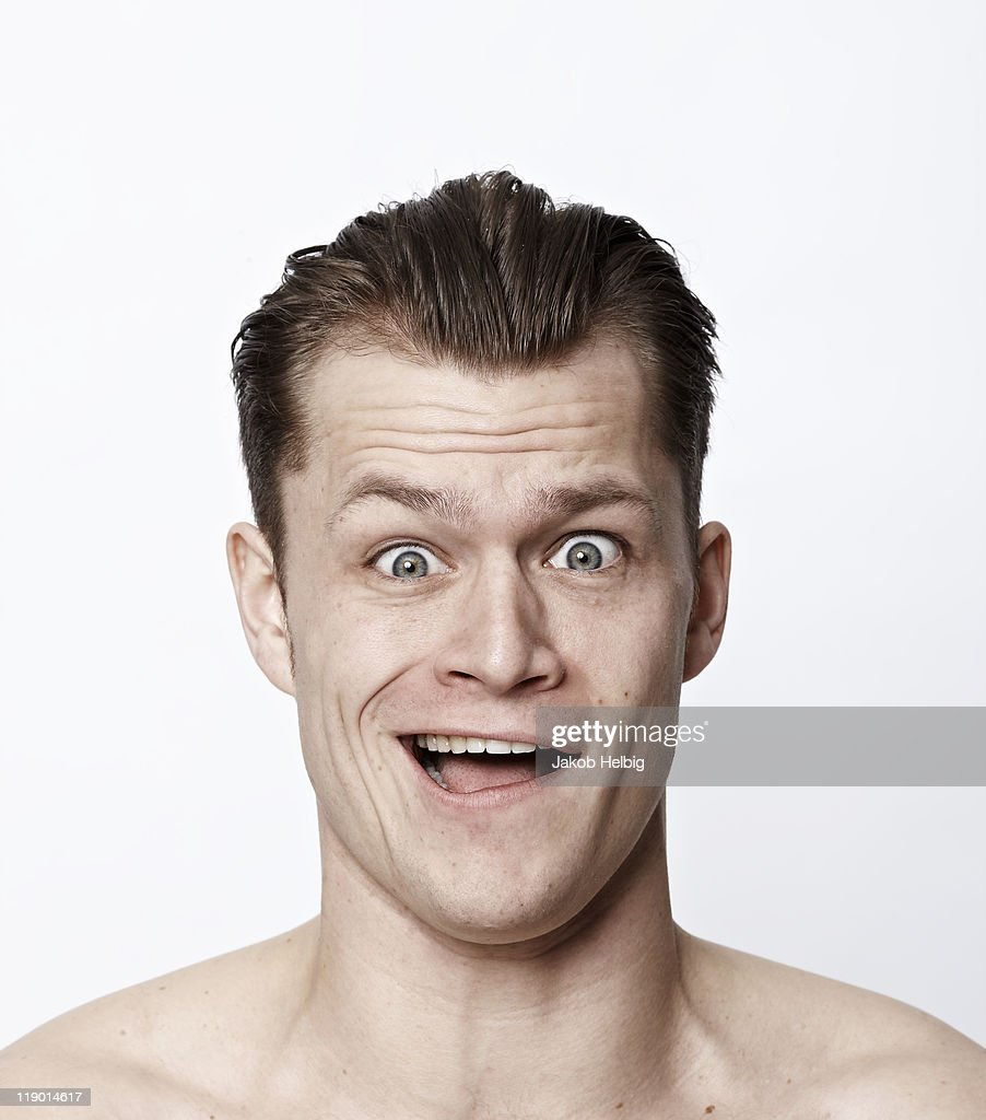 Nude man making a funny face : Stock Photo