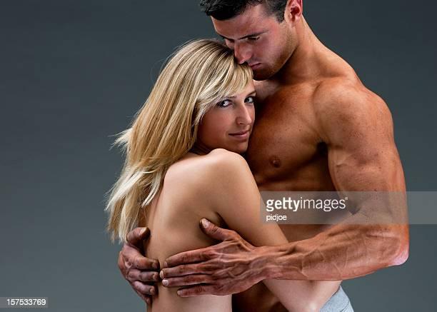 nude muscular man embracing fragile woman XXXL