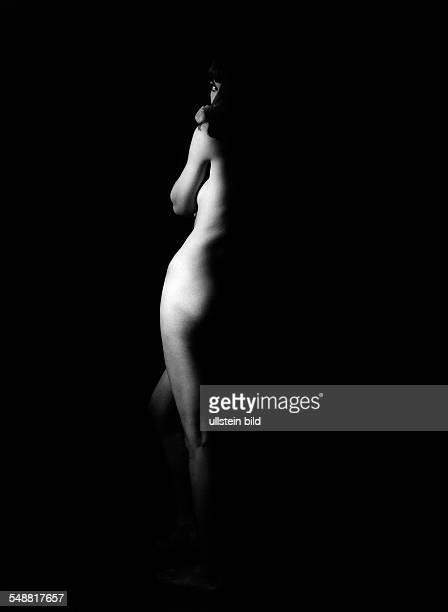 naked woman illuminated onesided 1970 Photographer Jochen Blume Vintage property of ullstein bild