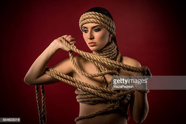 Nude woman in rope