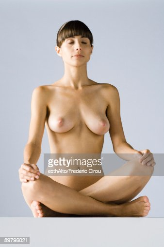 naked women sitting in a pole