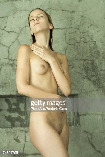 Standing naked in the shower