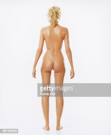 Girl standing at attention nude
