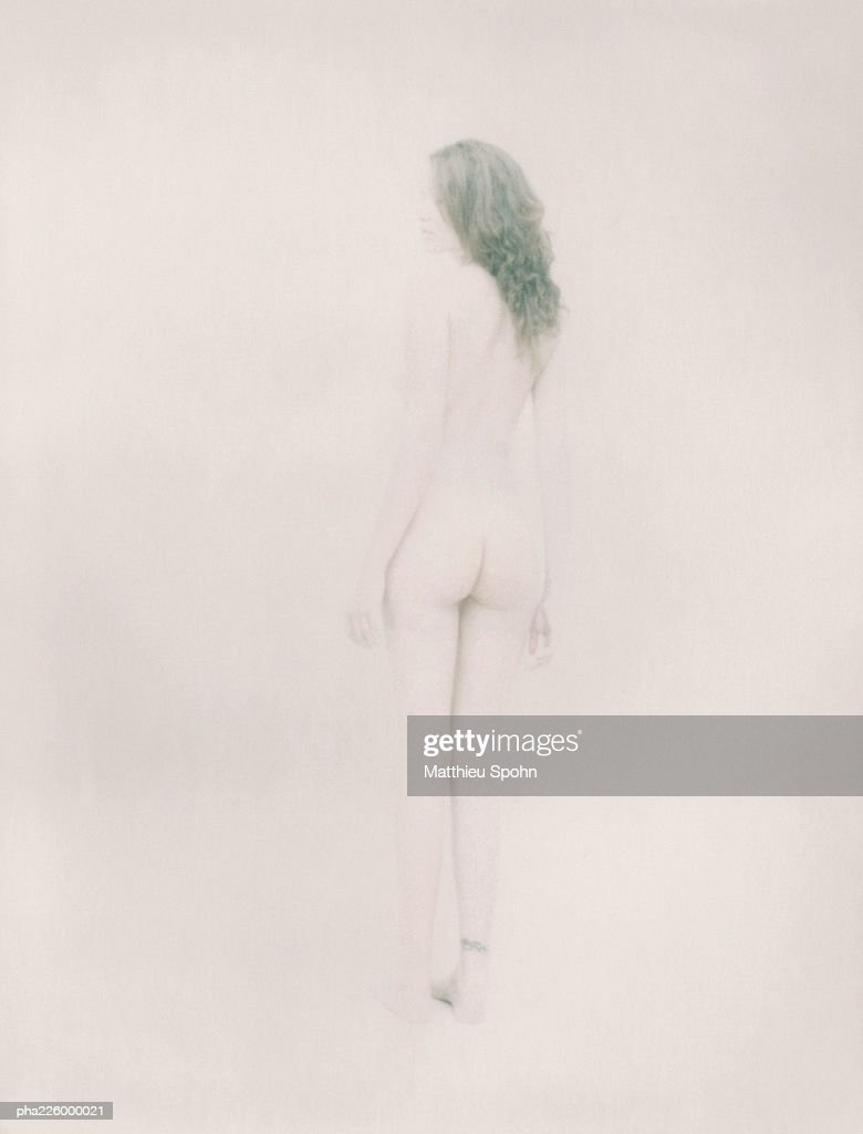 Nude woman standing, rear view. : Stock Photo