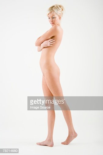 Nude woman with arms across chest : Stock Photo