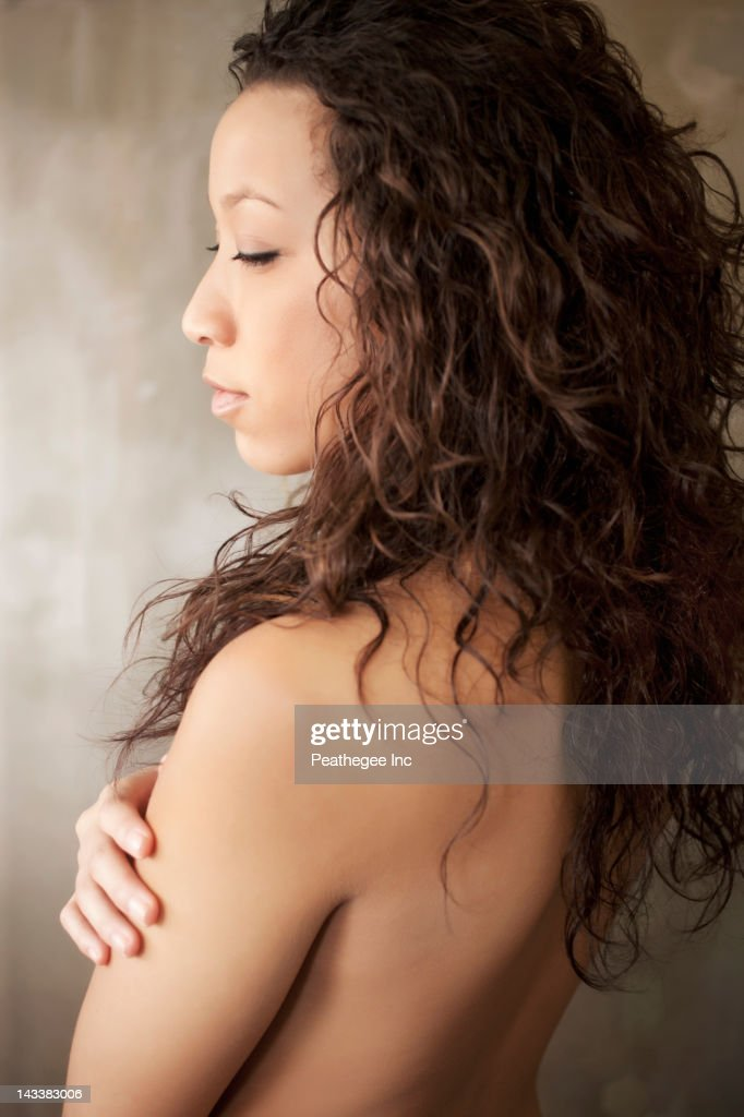 Nude woman with arms crossed : Stock Photo