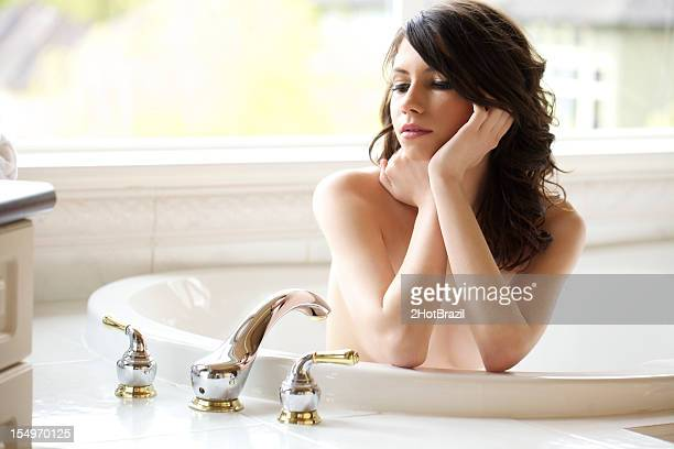 Nude Young Woman in tub