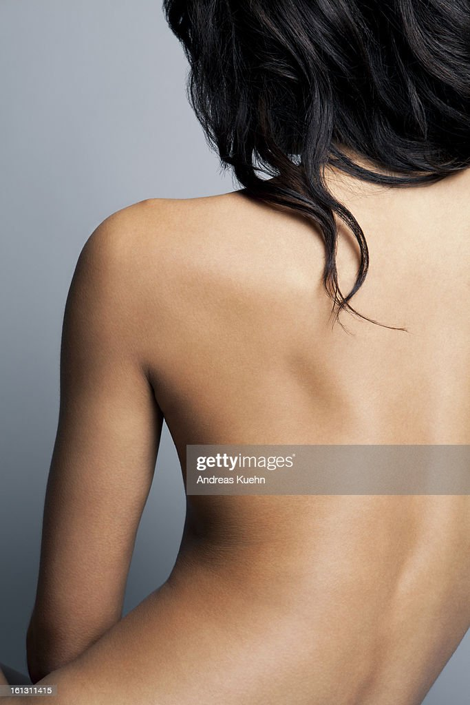 Nude young woman with her back towards camera. : Stock Photo